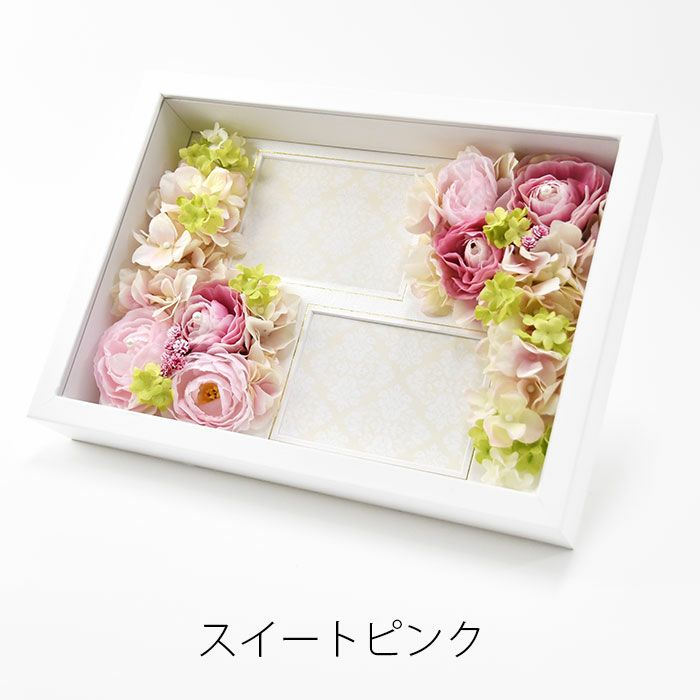 やさしいピンクのお花をアレンジしたフォトフレームの贈呈品