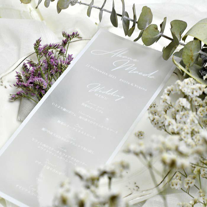 やさしい透け感のトレーシングペーパーにホワイトインクをのせて結婚式にふさわしい特別感を演出