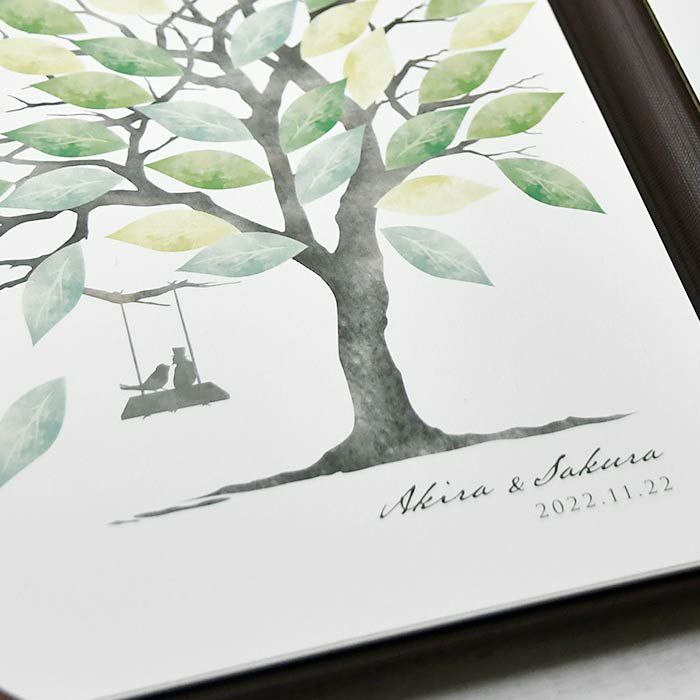ゲストとの絆をあらわす大きな木に、ちょこんとブランコに乗っているのはお二人を象徴した小鳥のカップル