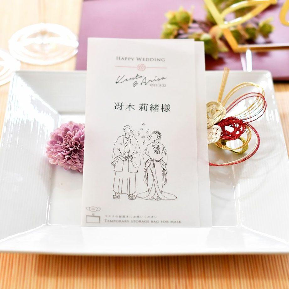 結婚式のゲストテーブに置かれた席札になるマスクケース